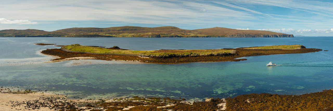Panoramic view on tidal island Lampay at low tide. - Isle of Skye, 2017 Island Scotland Claigan Isle Of Skye Claigancoralbeach Loch Dunvegan Lampay Island Tidal Island Sailboat Turquoise Colored Outdoors Rock Idyllic Non-urban Scene Mode Of Transportation Day Nature Transportation Cloud - Sky Sky Tranquility Mountain Tranquil Scene Beauty In Nature Nautical Vessel Scenics - Nature Sea Water EyeEm Best Shots EyeEm Nature Lover