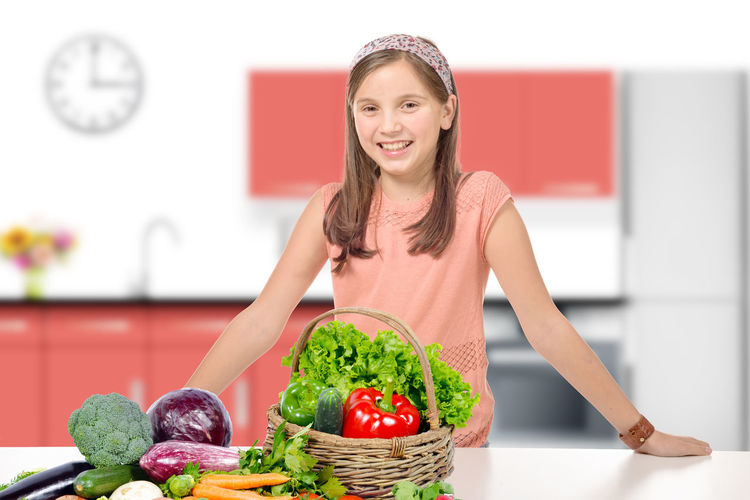 Basket Cheerful Day Domestic Life Enjoyment Focus On Foreground Food Food And Drink Freshness Happiness Healthy Eating Healthy Lifestyle Indoors  Lifestyles Looking At Camera One Person Portrait Red Smiling Tomato Vegetable