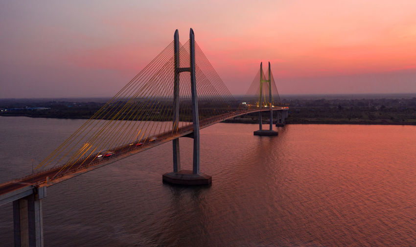 View of bridge over sea during sunset