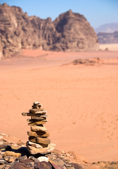 Stack of rocks on sand at desert