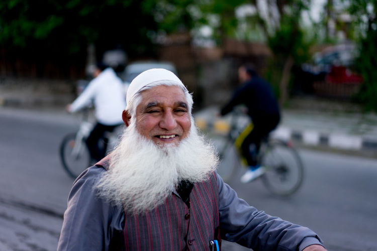 Portrait of smiling man on street in city