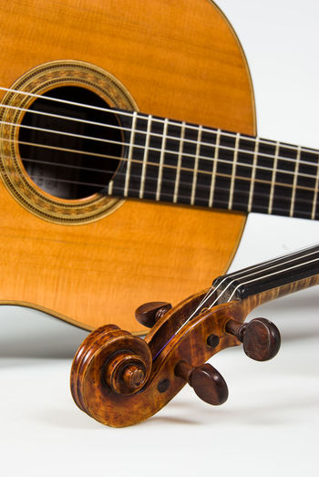 Close up of guitar and violin Acoustic Guitar Arts Culture And Entertainment Close-up Guitar Indoors  Music Musical Equipment Musical Instrument Musical Instrument String String Instrument Violin Wood - Material