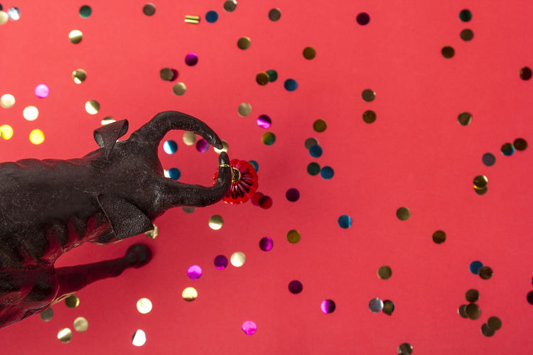 Ox with christmas ball on horns on red background, banner. buffalo, bull as symbol of year 2021