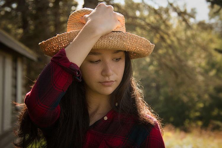 Close-up of teenage girl wearing hat