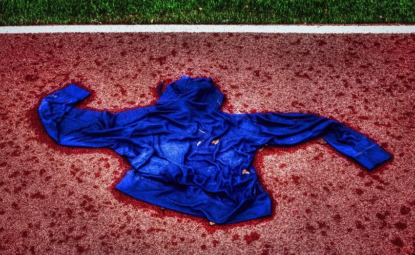 Wet jacket Windbreaker Abandoned Blue Clothing Gravel Hoodie Jacket On The Ground Rain Gear Textile Wet Wet Jacket