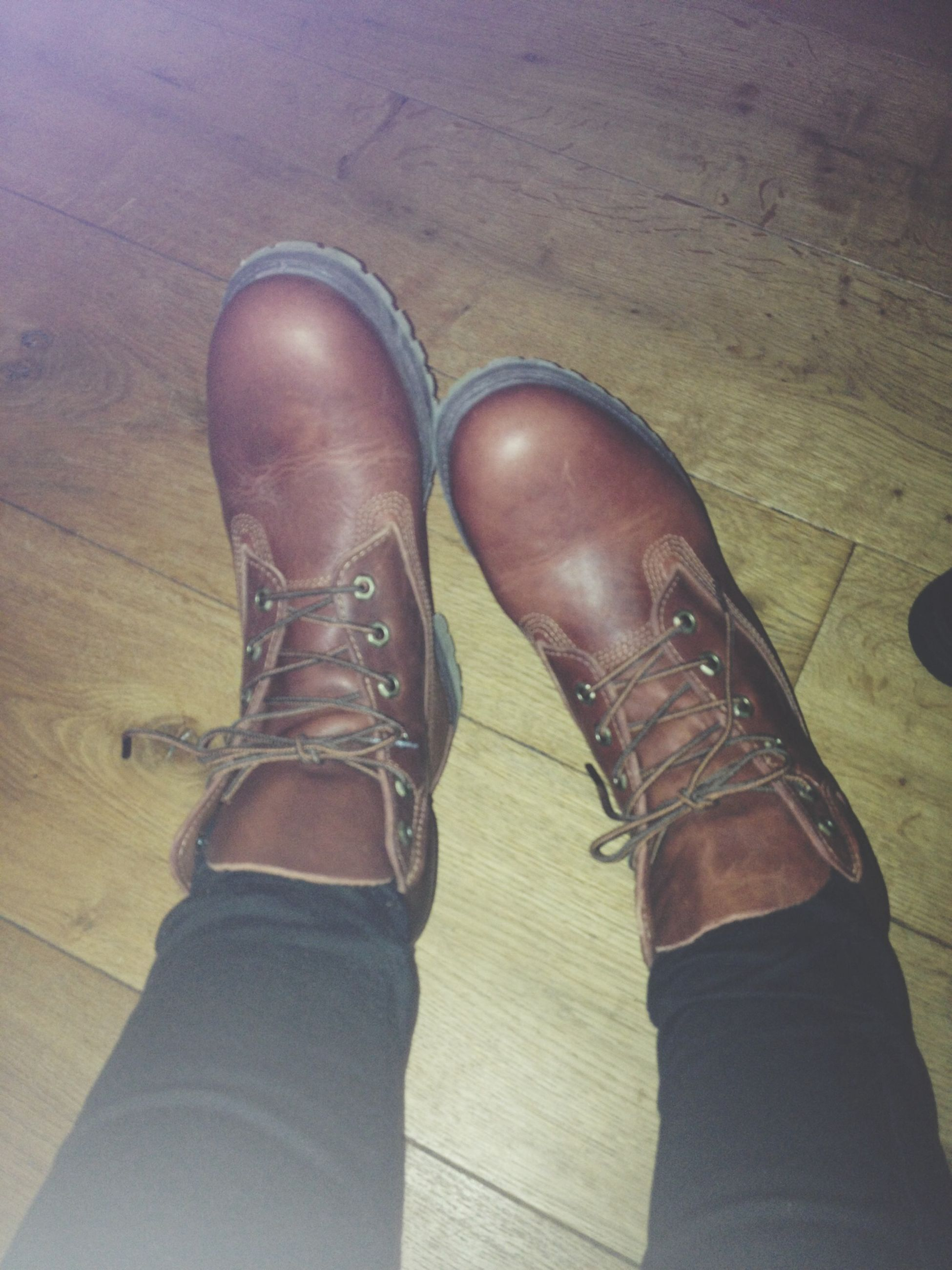 low section, shoe, person, personal perspective, footwear, human foot, indoors, jeans, high angle view, close-up, part of, pair, canvas shoe, fashion, standing, flooring, wood - material