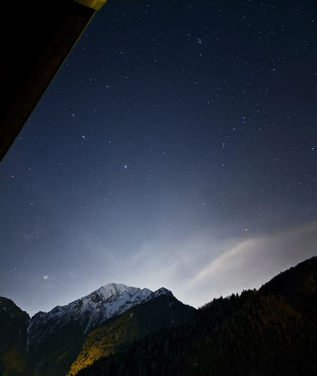 Low angle view of mountain against sky at night