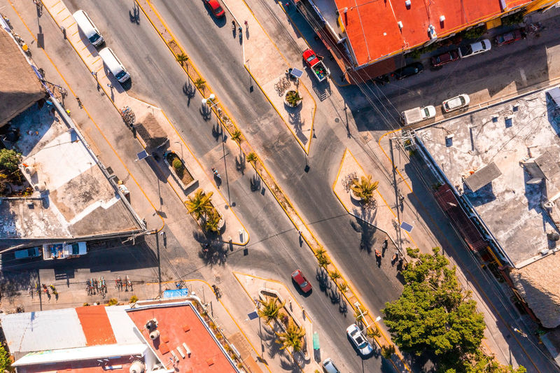 Aerial view of the street intersection with cars driving down the road.
