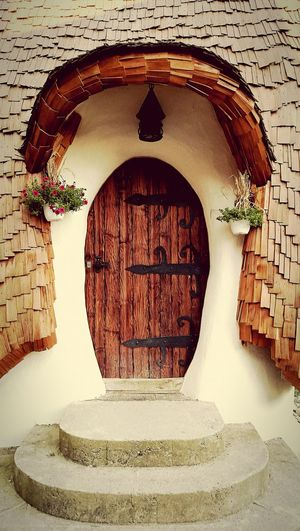 Doors Vintage Photo Vintage Doors Fairy Tale Old House Pretty Flowers Wodden Door Architecture Vintage Architecture New And Old House In Nature Followme Wood And Metal Stone Wall Stones Nature House By The River Architecture Details Showcase July Hidden Gems  Home Is Where The Art Is Colour Of Life The Architect - 2017 EyeEm Awards