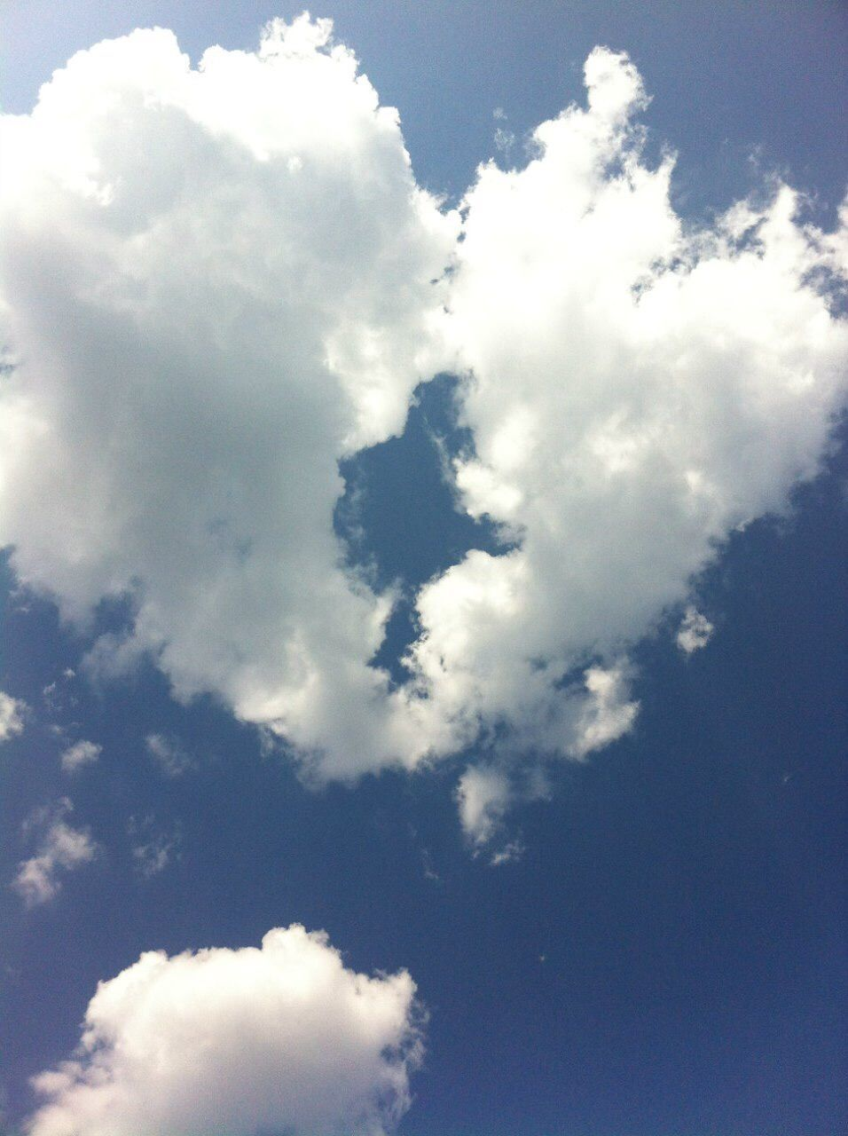 cloud - sky, sky, low angle view, beauty in nature, tranquility, nature, no people, scenics - nature, day, outdoors, backgrounds, blue, white color, full frame, tranquil scene, idyllic, sunlight, cloudscape, heaven, softness, meteorology, high, height