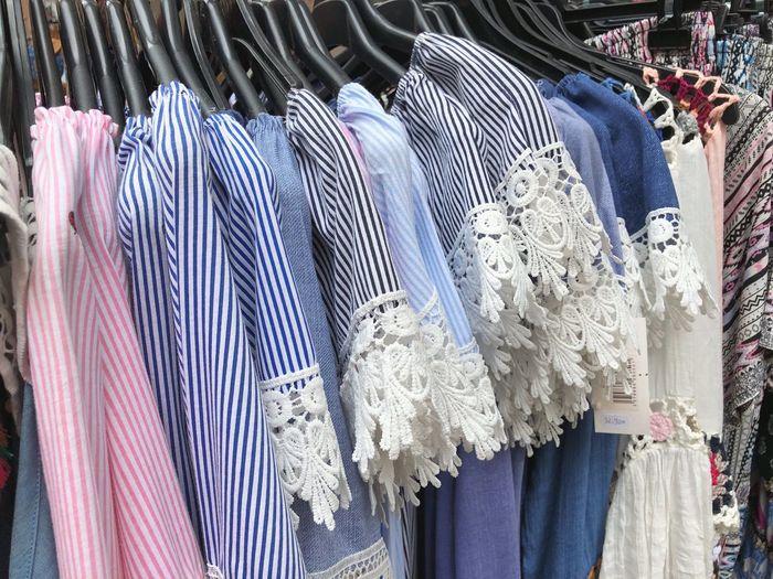 Full frame shot of dresses for sale in store