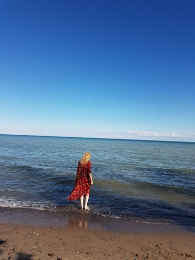 Summer memories with @juliaharris. Nature Outdoors Objects Reflection Blue Nikon Photography Water Beach Clear Sky Wave Full Length Sand Sky Horizon Over Water Shore Sandy Beach Calm FootPrint Ankle Deep In Water A New Perspective On Life