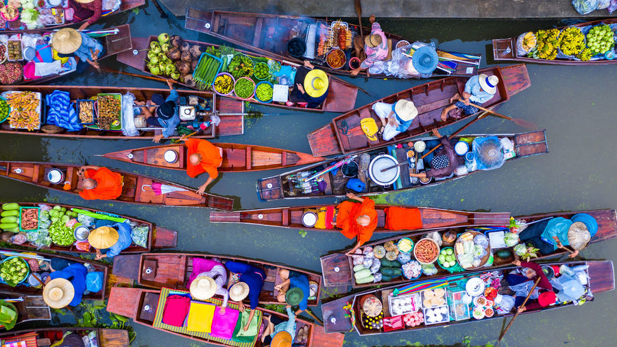 Aerial view of floating market in river