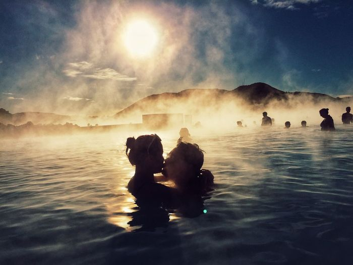 Couple Kissing While Swimming In Hot Spring