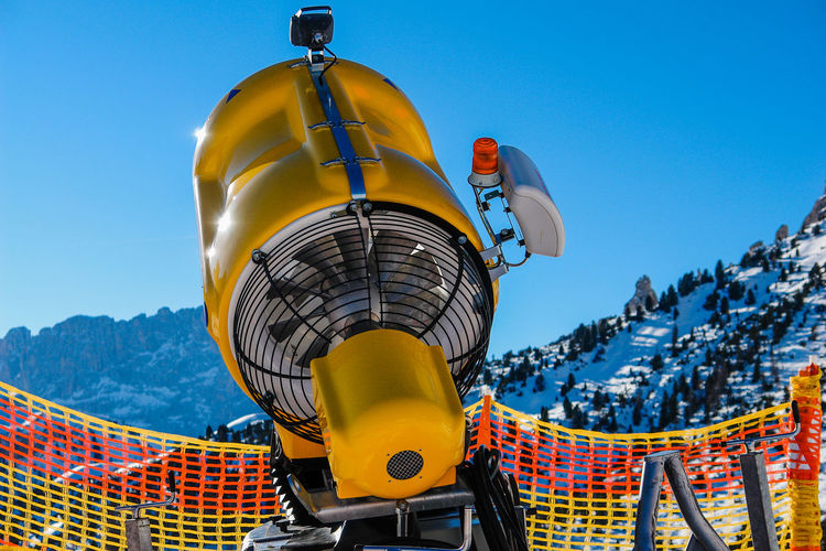 In The Mountains Preparing For Winter Ski Slope Sunny Winter Winter Sport Artificial Snow Blue Clear Sky Close-up Colorful Day Low Angle View Mountain Nature No People Outdoors Preparing Ski Slope Sky Snow Cannon Technology Yellow Yellow Color Shades Of Winter