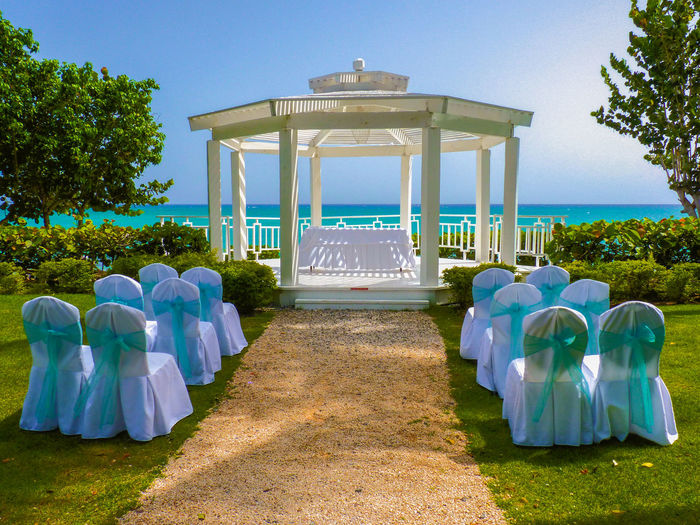 Ready for tropical wedding, La Romana, Dominican Republic Beauty In Nature Blue Carribean Chairs Clear Sky Day Dominican Dominican Republic Dream Footpath Green Color La Romana Love Nature Ocean Outdoors Paradise Republic Scenics Sea Tree Tropical Turquoise View Wedding