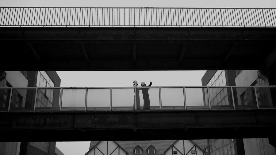SnipeAnonymous Bridge - Man Made Structure Architecture Built Structure Connection Real People Low Angle View Men Day Transportation Bridge Lifestyles Architectural Column Outdoors Sky One Person People Hasselblad X1d Your Ticket To Europe Investing In Quality Of Life The Week On EyeEm