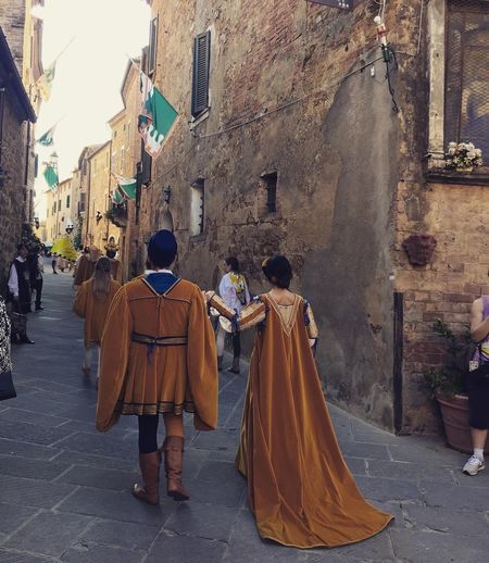Once upon a time 😍 EyeEm Best Shots Festival Medieval Traveling Travel Destinations Travel Italy🇮🇹 Italy❤️ Italy Tuscany Street City Architecture Built Structure Building Exterior Full Length Real People Group Of People Women Rear View Clothing Adult Lifestyles Men Day Building People Walking Leisure Activity Transportation