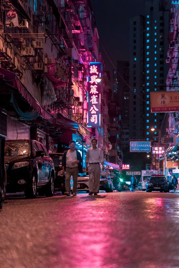 After The Rain Outdoors Road Men Leisure Activity Building Women People Incidental People City Life Group Of People Transportation Walking Lifestyles Real People Built Structure Street Architecture Illuminated Building Exterior Night City EyeEm Gallery EyeEm Selects EyeEm Best Shots Old Buildings Tsuen Wan Neon Colored Neon Sign Neon Lights Cyberpunk My Best Photo