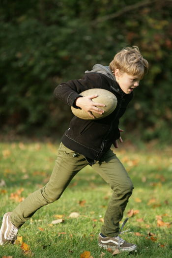Lifestyles Adolescence  Teenage Boys Rugby Family Childhood Child Offspring Full Length Boys Men One Person Outdoors Field Innocence Autumn Mood