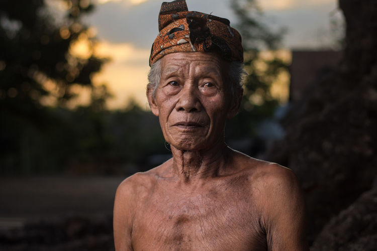 Portrait of old man primitive tribe against blurred background