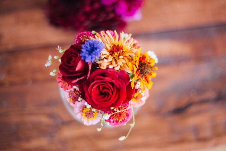 High angle view of bouquet on wooden table