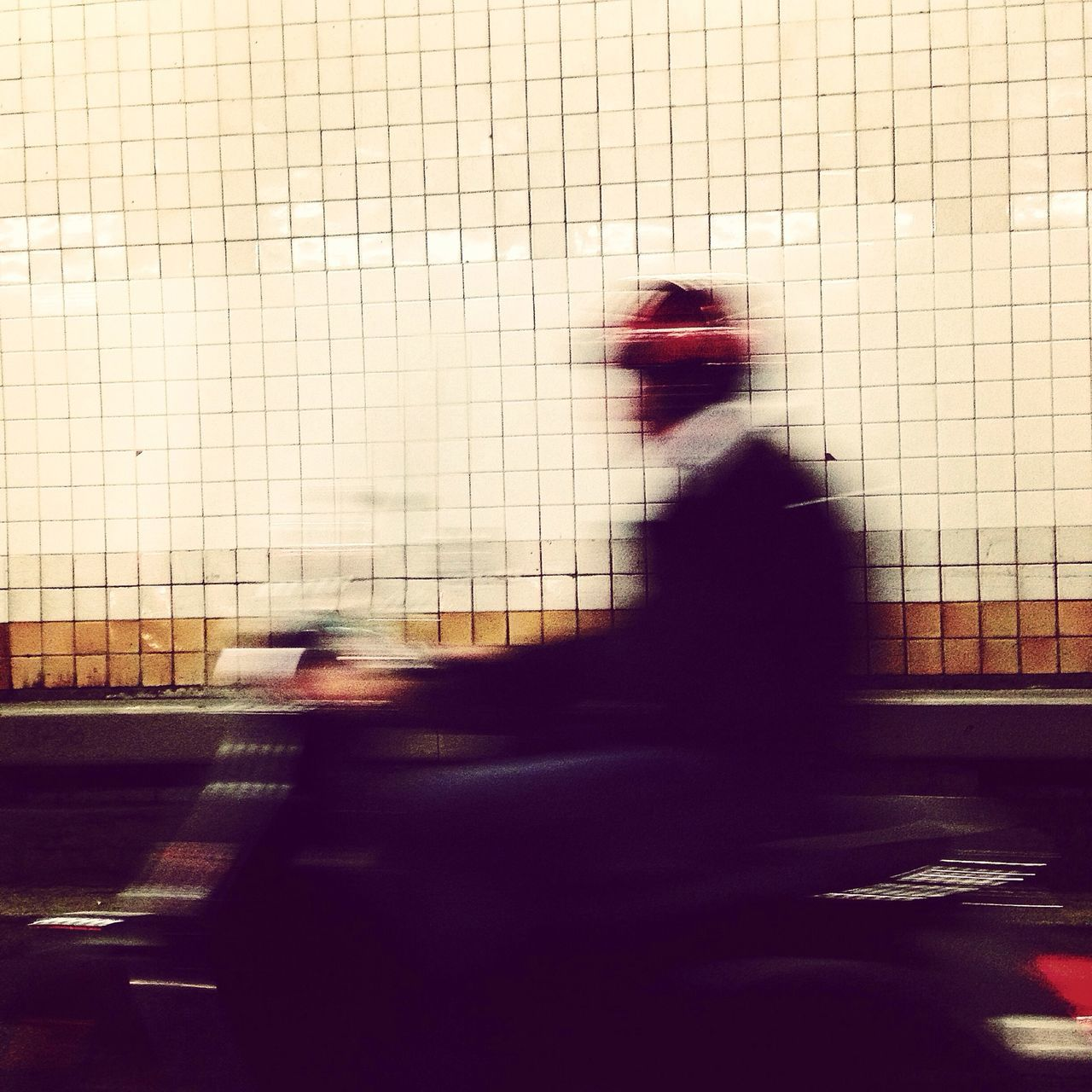 Blurred Image Of Man Riding Motor Scooter In Tunnel