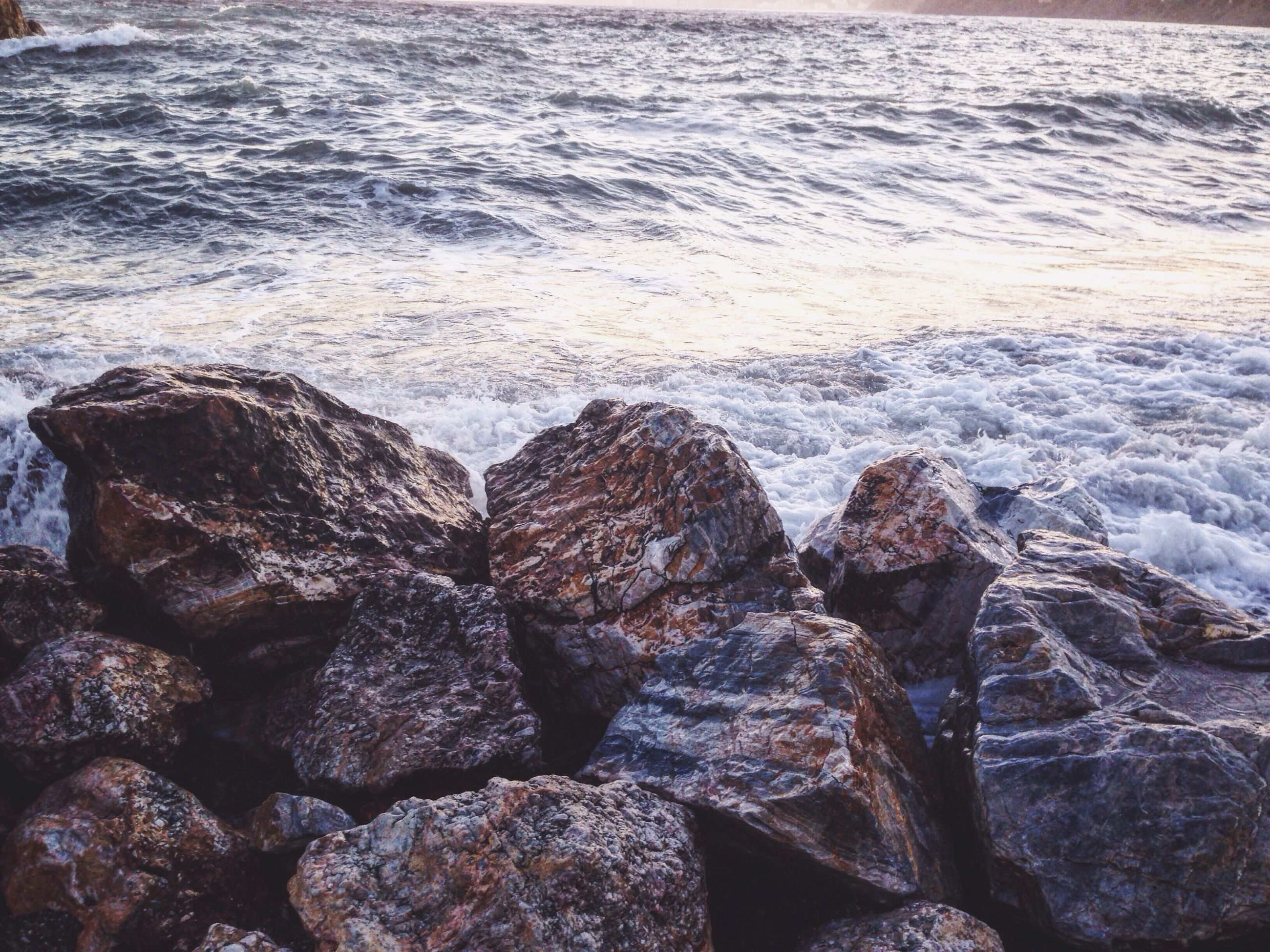 sea, water, rock - object, rocky, beach, shore, nature, wave, rough, rippled, beauty in nature, day, scenics, outdoors, power in nature, tranquil scene, geology, tranquility, rock, non urban scene, rock formation, coastal feature, no people, non-urban scene, rocky coastline, water surface