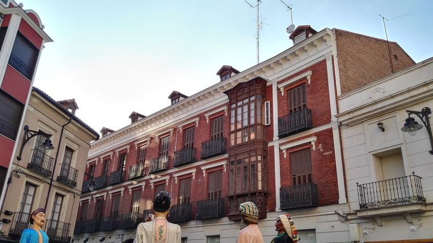 Adult Architecture Building Exterior Built Structure City Day Giants Horizontal Men Old Town Outdoors People Person Sky Town Square Tradition Traditional Travel Destinations