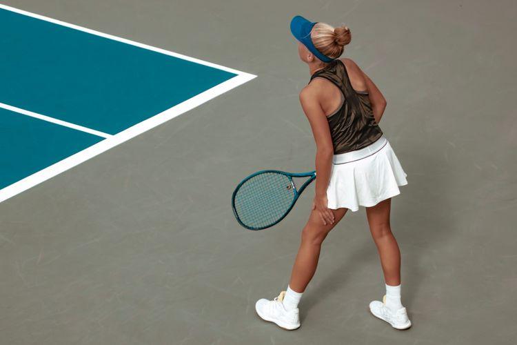 Tennis player playing tennis at court