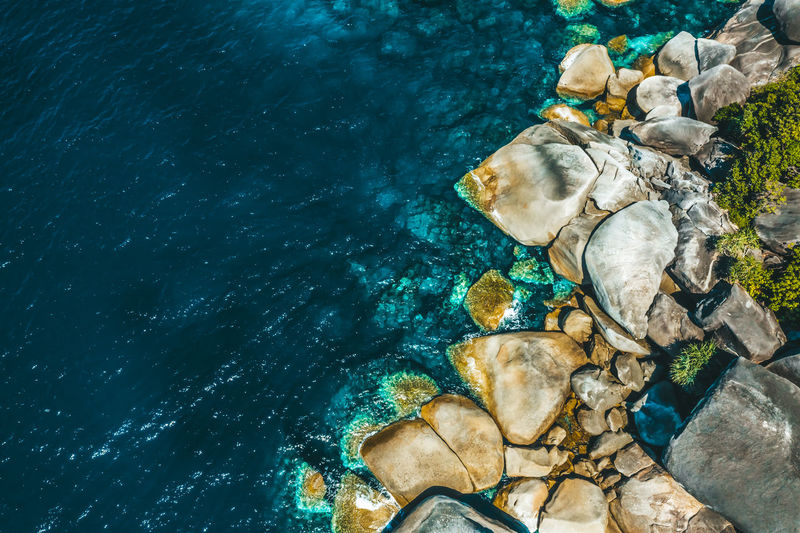 Aerial View of the rock in Boulder Island, Myanmar Summer Ocean Travel Tourists Areal View Top View Above Nga Khin Nyo Island Boulder Island Myanmar Green Blue Stone Andaman Sea Life Marine Turquoise Colored Day High Angle View Nature Rock Sea Water Aerial View