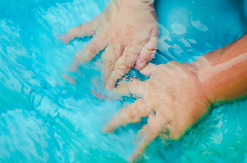 Swimming Pool Pool Water Real People Blue Human Body Part Body Part Lifestyles Leisure Activity People Child Nature Relaxation High Angle View Baby Young Hand Human Limb The Minimalist - 2019 EyeEm Awards