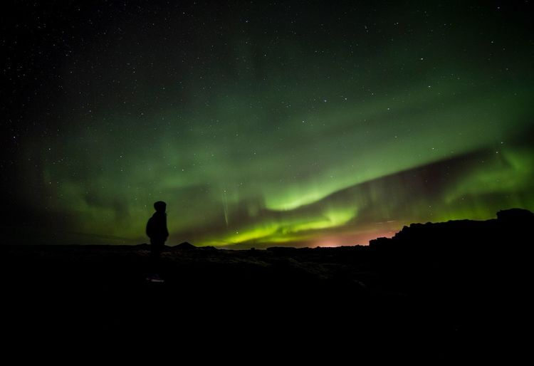 Aurora borealis by the blue lagoon on Iceland. Night Star - Space Space Astronomy Beauty In Nature Sky Scenics - Nature Silhouette Space And Astronomy Dark