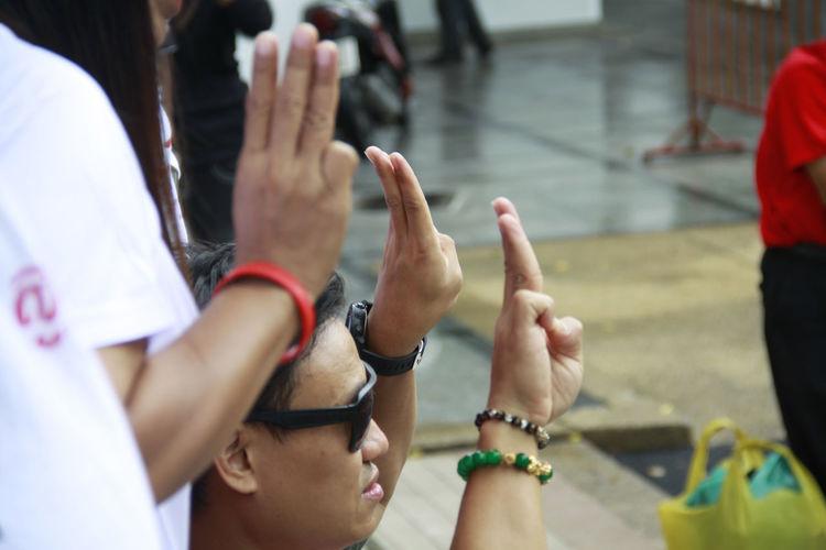 Group of people gesturing on street