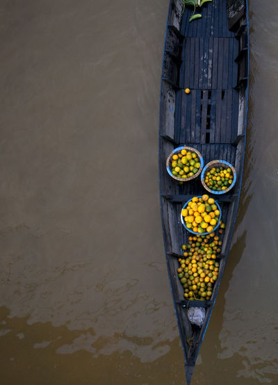 Directly Above View Of Fresh Orange Fruits In Boat On River
