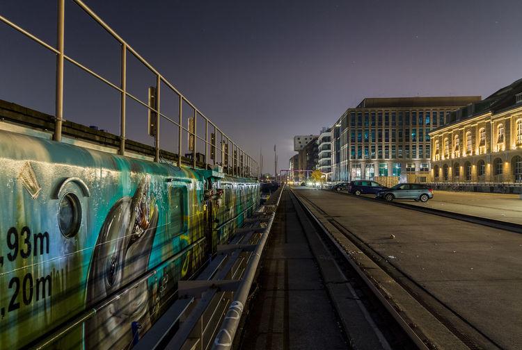 Train on railroad tracks against sky at night