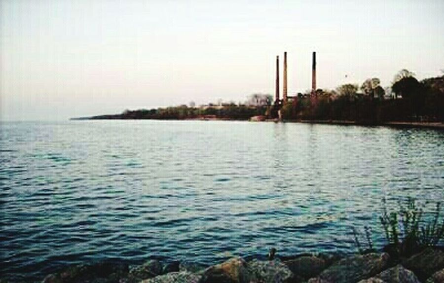 Water Outdoors Waterfront Nature No People Industry Sky Horizon Over Water Day Nooneknows Spoonie  Eyeemphotography EyeEmNewHere Beauty In Nature Scenics Tranquility Rock - Object Lake Erie Lake Sunset Water Reflections Rocks And Water