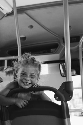 Portrait of smiling boy in car