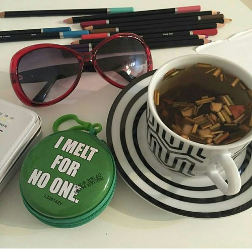EyeEmNewHere Tea Glasses Colourpencils Herbal Tea Nopeople Onthedesk Nomelting Greenbox Readytorelax Close-up