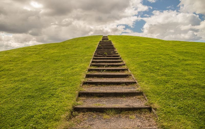 Steps On Field Against Sky