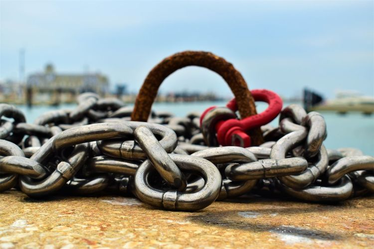 Close-up of chain at harbor