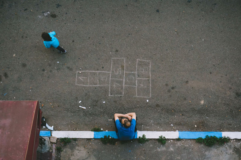 High angle view of man relaxing on street