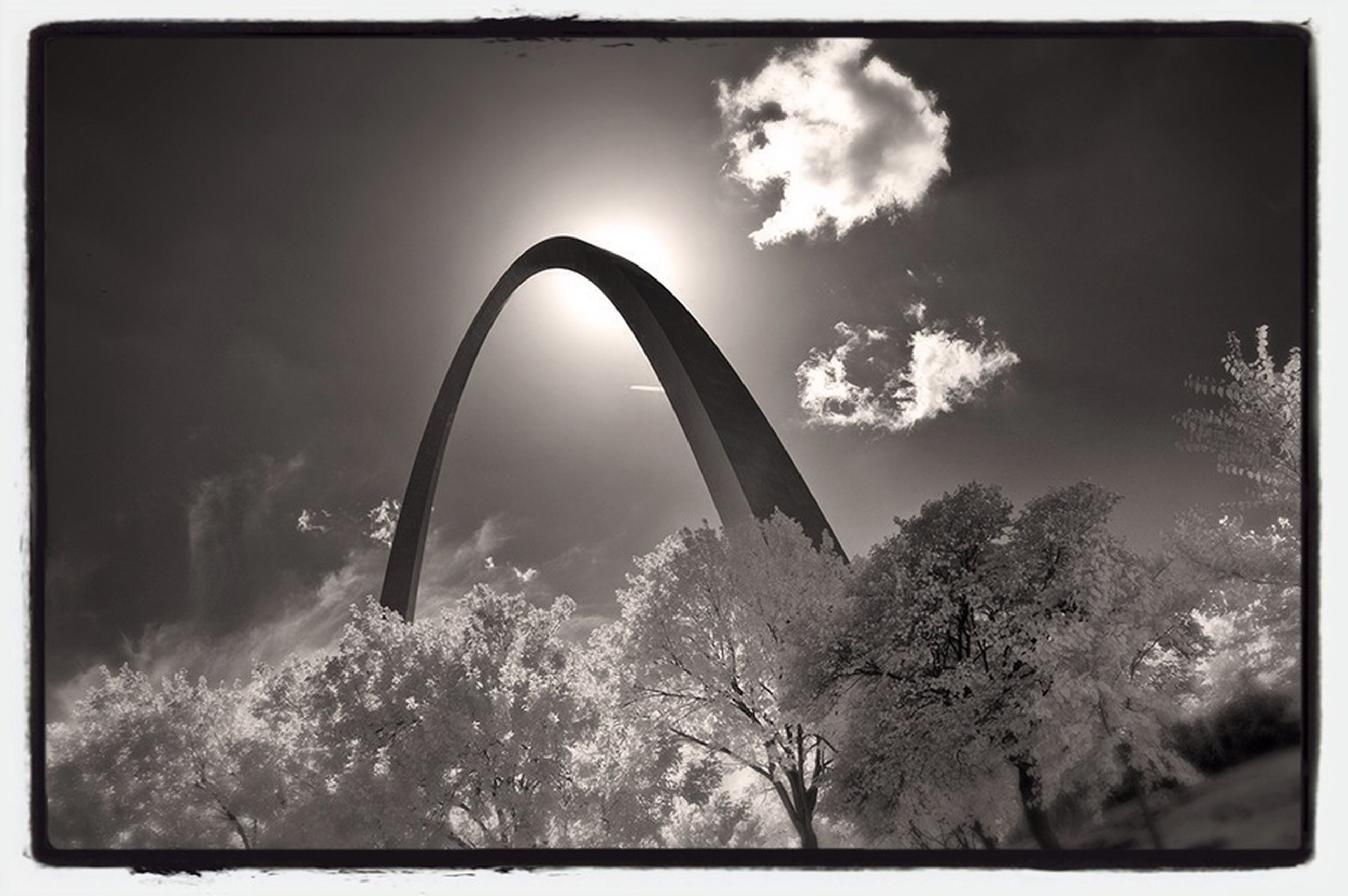 transfer print, auto post production filter, sky, tree, low angle view, cloud - sky, built structure, cloud, cloudy, architecture, connection, arch, nature, weather, bridge - man made structure, outdoors, no people, day, silhouette, tranquility