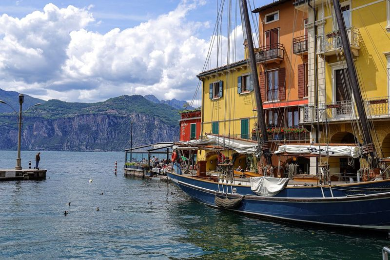 Water Nautical Vessel Transportation Mode Of Transportation Sky Building Exterior Architecture Nature Built Structure Cloud - Sky No People Day City Outdoors Travel Destinations Waterfront Travel Building Moored Fishing Industry
