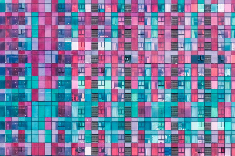 Turquoise Colored Grid Close-up Technology Textured  Pink Color Repetition Pixelated Abstract No People Geometric Shape Multi Colored Square Shape Design Backgrounds Apartment Highrise Housing AirBnB High Density Real Estate Windows Property Market Modern Architecture