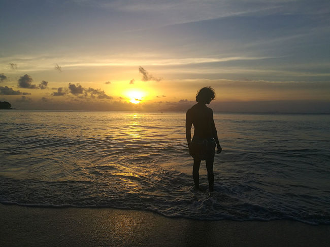Sunset Sea Beach Full Length One Person Sun Summer One Man Only Silhouette Rear View Water Reflection Only Men People Vacations Horizon Over Water Sky Aesthetic Berjaya Beach Seychelles Exploration Vacations Cloud - Sky Tranquility Adult Lost In The Landscape