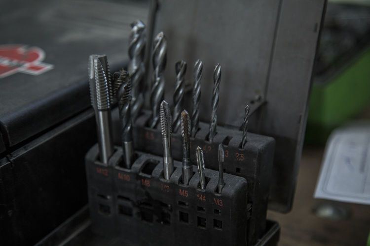 Close-up of drill bit in toolbox
