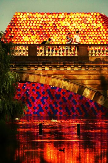 Mastaba at sunset Sunset Bridge Serpentine Mastaba Reflection Water Illuminated Multi Colored Built Structure Architecture Lake