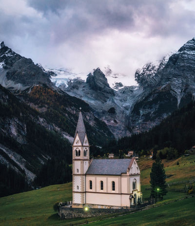 Church with bell tower in Trafoi village against Stelvio mountains in dusk, Alps in Italy Alpine Church Italy 🇮🇹 Alps Building Exterior Cloud - Sky Dusk Italy Landscape Mountain Mountain Range Nature Place Of Worship Scenics Snow Stelvio