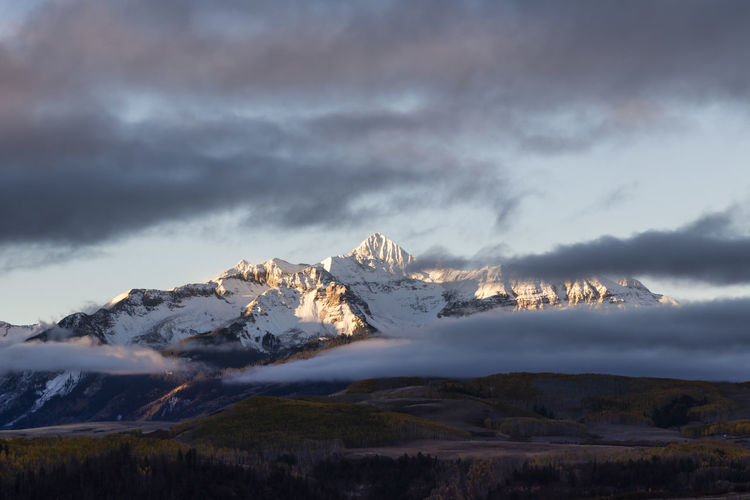 Snowcapped Wilson Peak in Colorado's San Juan Mountains range at sunrise, San Miguel County Snowcapped Mountain Mountain Peak Landscape Nature Cold Temperature Scenics - Nature Cloud - Sky Mountain Snow Wilson Peak San Juan Mountains San Miguel County Sunrise Beauty In Nature Colorado Fall Autumn Mountain Range Outdoors Tranquil Scene